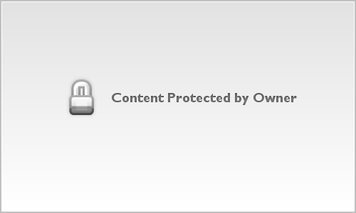 The US Supreme Court Building shot in the winter snow at night with person with red umbrella