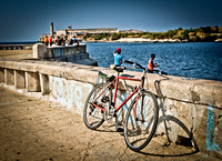 Bike and fishers on the shores of Malecón In Havana Cuba